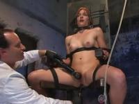 Tied redhead gets treated with a vibrator