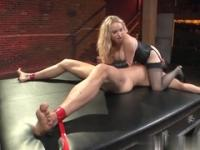 Blonde Aiden Starr in bondage action