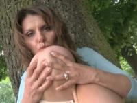 Milf with huge tits shows her goods in nature