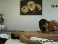 A naked Asian girl gives a special massage