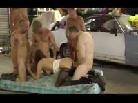 A redhead gets gangbanged at the auto garage