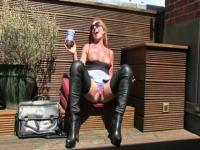 The blonde MILF drinks coffee with spunk on the terrace