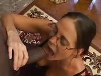 Nerdy cougar sucking a huge black pecker