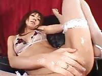 Fishnet-clad Asian tart stroking her wet pussy