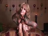 Tattooed MILF's wax play and masturbation solo