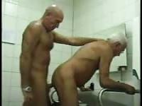 Two old guys in the bathroom suck cock and fuck butt