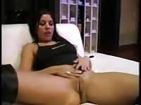 Hot brunette in knee high boots is going to suck you and fuck you right