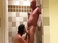Mature couple getting each other off in the shower