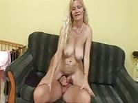 Blonde MILF likes to play on the couch with her stud