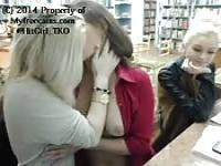 Three amateur girls playing with each other in the library