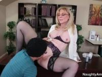 Alluring buxomy experienced lady Nina Hartley in stockings