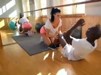 Brunette exercising with black guy