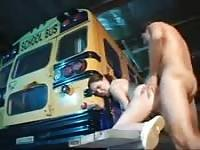 Bus driver bangs schoolgirl behind the bus