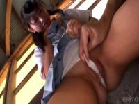 Adorable Japanese teen is fingering her pussy