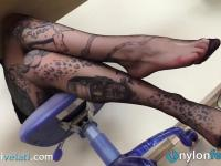 Tattoed secretary in pantyhose teases you with her feet