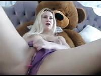 Horny blonde masturbates near stuffed animal