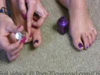 Hot girl polishing her toes with nail polish