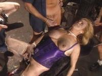 Blond mature gangbang in dirty garage