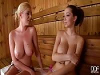 Two busty girls in a sauna