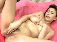 Oiled up busty Japanese plays with her hairy pussy