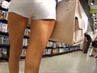 Slim Brunette In Tight White Shorts