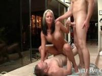 Slutty blonde MILF humping and sucking two dicks at once