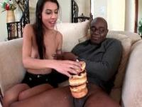Brunette slut blowing on a long and fat black man stick