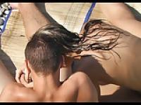 Voyeur on public beach. Girl touching dick of his friend