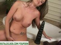 Busty girl playing with two big dildos