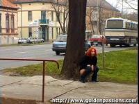 Mature redhead taking a piss in a public park