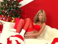 Blonde does a holiday strip tease in lingerie