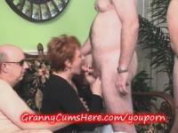 Granny sucks cock at the swingers party